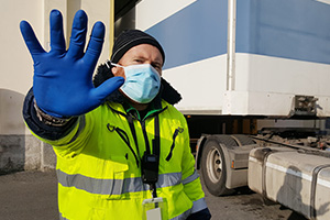 Lorry driver wearing mask